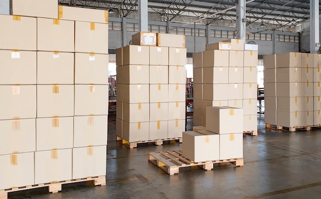 Stack of cardboard boxes on wooden pallet in distribution warehouse