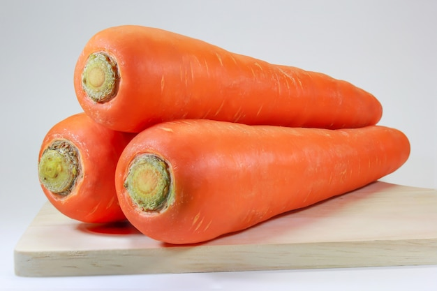 Stack of carrots on the chopping board.