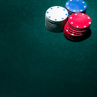 Stack of casino chips on green table