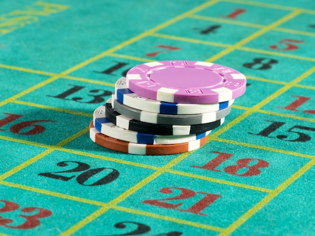 Stack of casino chips on a numbered board