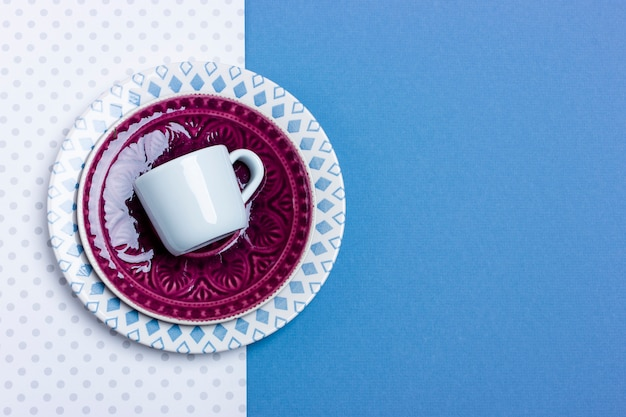 Stack of ceramic plates and espresso cups. simple design, close-up top view. place for your text.