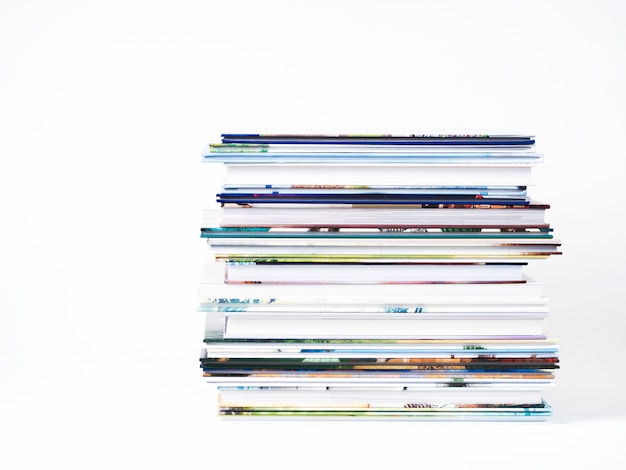 Stack of children's books on a white background.