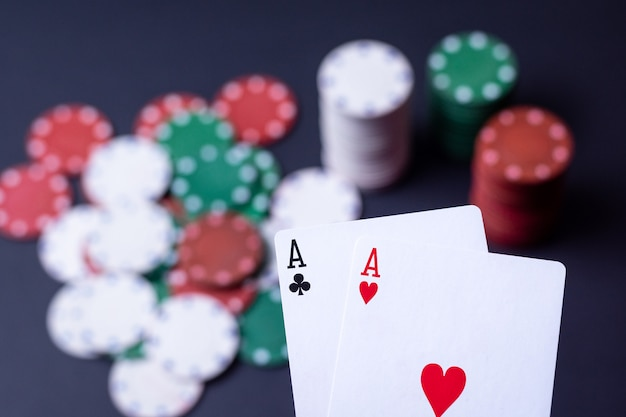 Stack of chips and two aces on the table