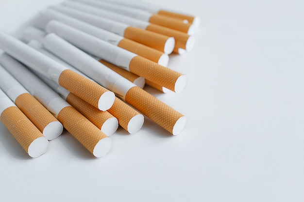 A stack of cigarettes on a white table. prevention of bad habits and addiction. selective focus.