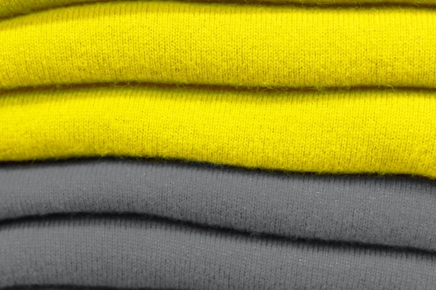A stack of clothes trend colors 2021 illuminating and ultimate gray.