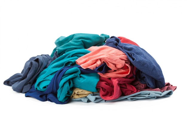Stack of clothes on white , closeup