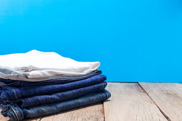 Stack of clothes on wooden plank.