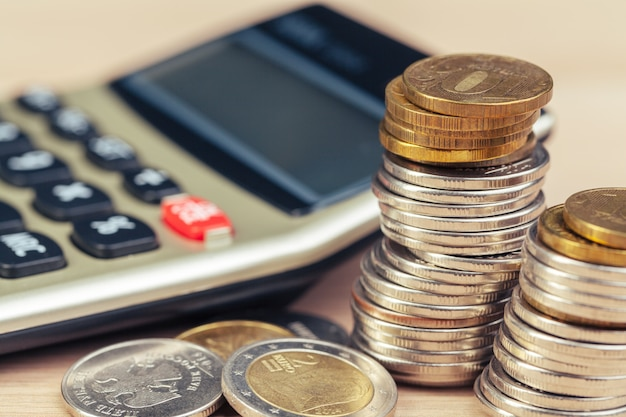 Stack of coins and calculator, concept for business finance
