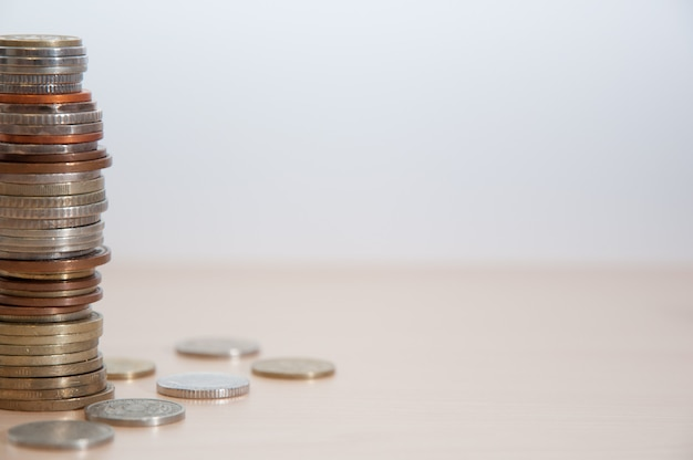 A stack of coins of different countries, color, dignity and size on the left at the edge of the picture.