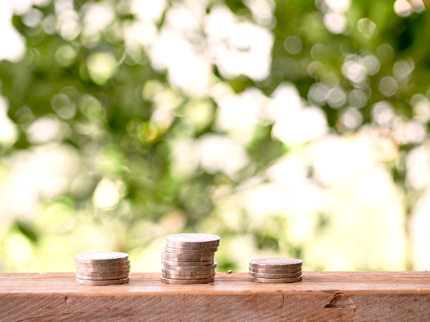 Stack of coins on table outdoors