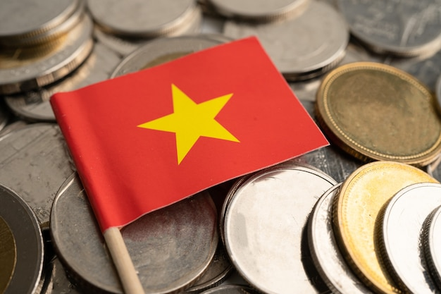 Stack of coins with china flag on white background. flag on white background.