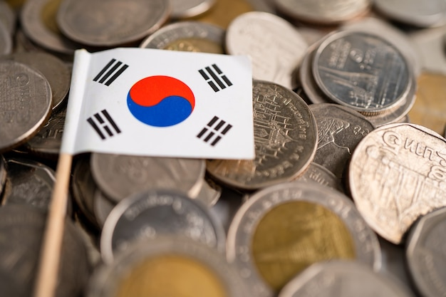 Stack of coins with korea flag on white background. flag on white background.