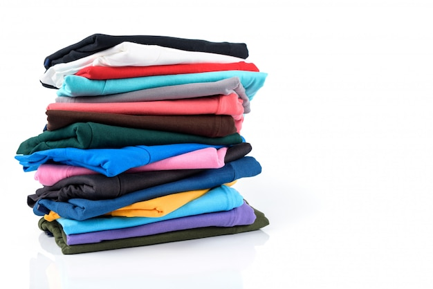 Stack of colorful cotton t-shirt isolated on white.