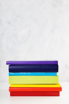 Stack of colorful rainbow books