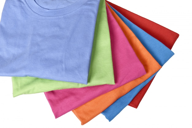 Stack of colorful t-shirts folded neatly