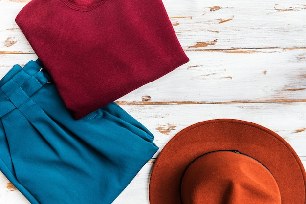 Stack of colorful warm autumn and winter clothes