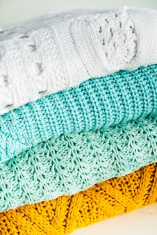 Stack of cozy cotton knitted sweaters