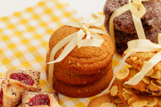 Stack of crunchy tasty cookies on a kitchen table close up