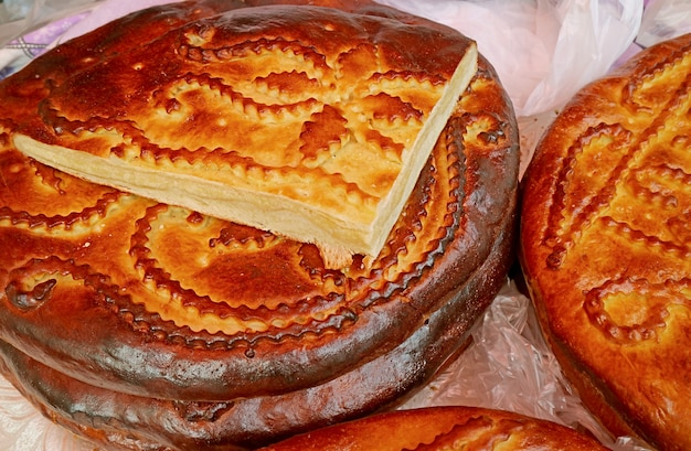 Stack of delicious gata a traditional armenian sweet breads at geghard monastery armenia