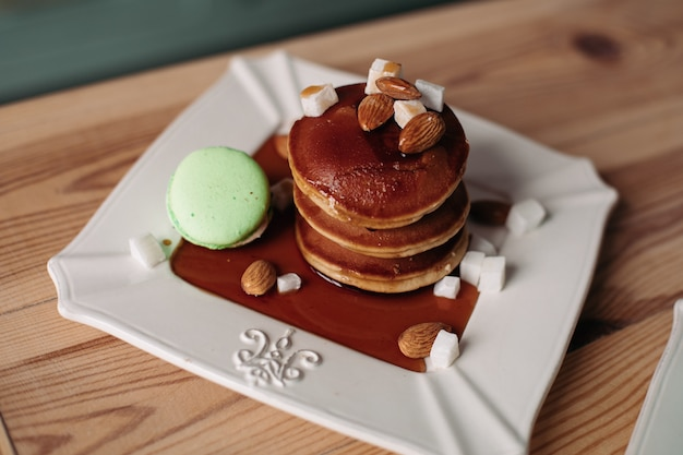 Stack of delicious homemade pancakes with almond and macaroon.