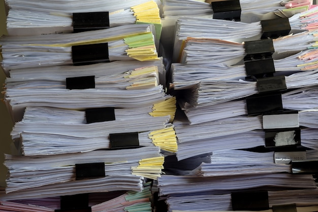 Stack document file pace on cabinet in office.