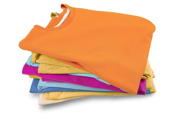 Stack of folded garments. closeup over white background.
