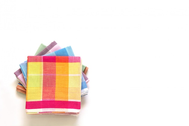 Stack of folded handkerchiefs on white background, copy space