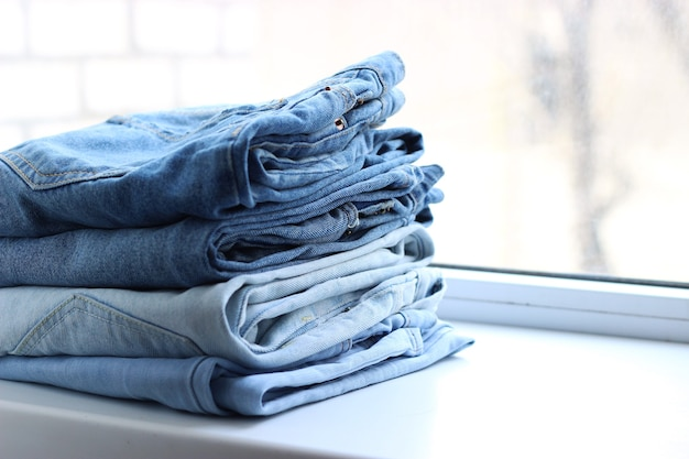 Stack of folded jeans on the table