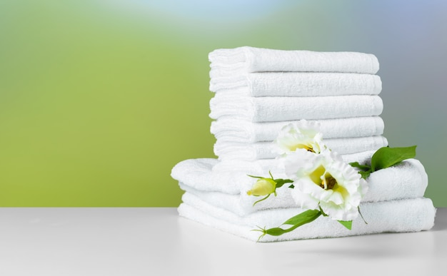Stack of folded white spa towels