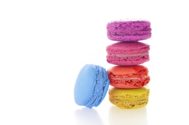 Stack of french macarons on white background