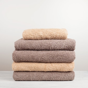 A stack of fresh bath towels folded on the table.