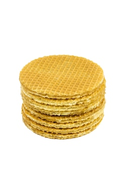 Stack of fresh homemade waffles with caramel cream isolated on a white background. fresh homemade cakes.