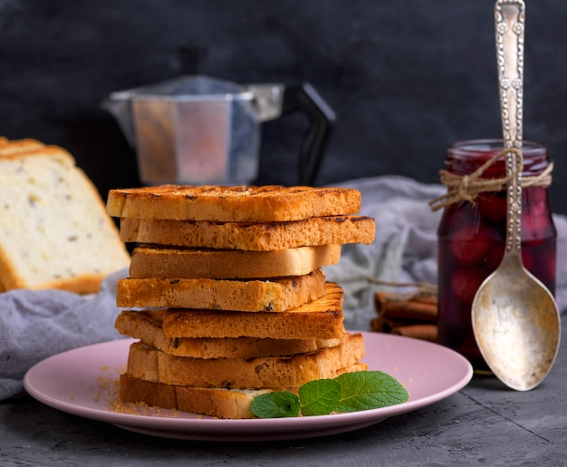 A stack of fried square slices of bread