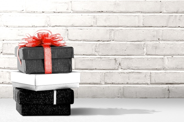 Stack of the gift box on the table with a wall