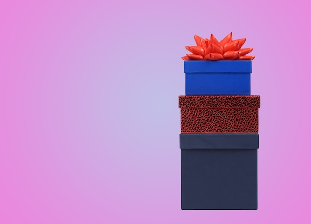 Stack of gift boxes on pink surface
