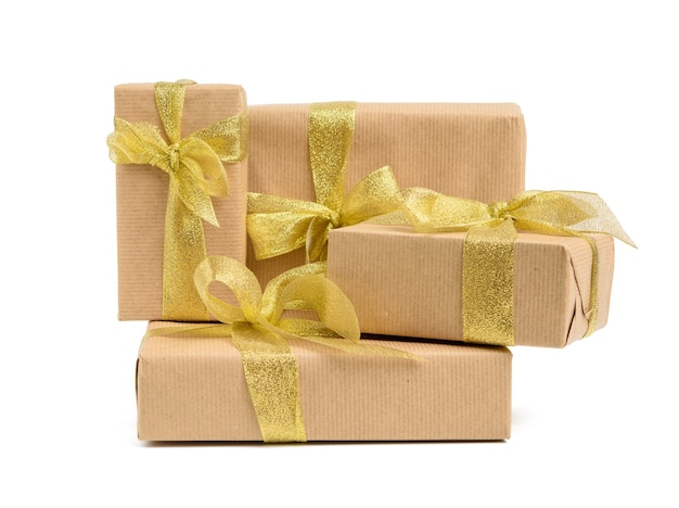 Stack of gifts wrapped in brown kraft paper and tied with silk ribbon, boxes isolated on white background, element for designer