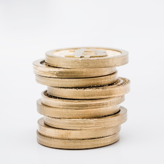 Stack of gold coins against white background