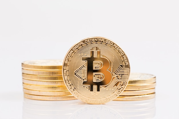 Stack of golden bitcoin on white background