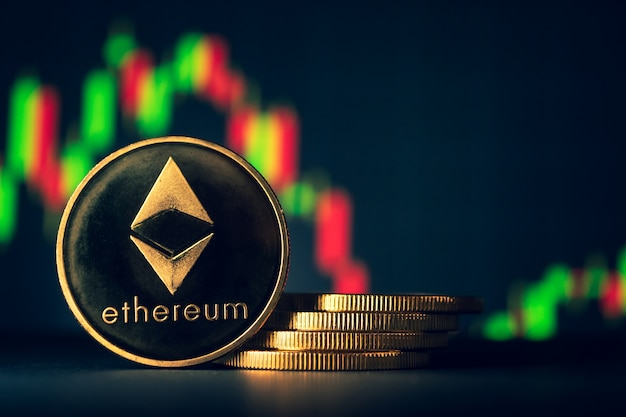 Stack of golden coins with ethereum symbol with stock graph background.
