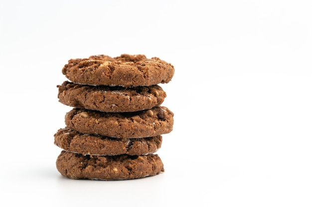 Stack of homemade sweet chocolate cookies isolated on white.