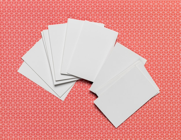 Stack of invitations on colored background