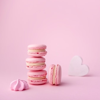 Stack of macarons with meringue and heart