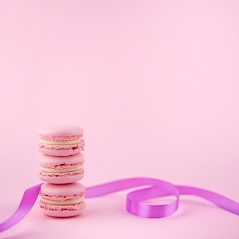 Stack of macarons with ribbon and copy space
