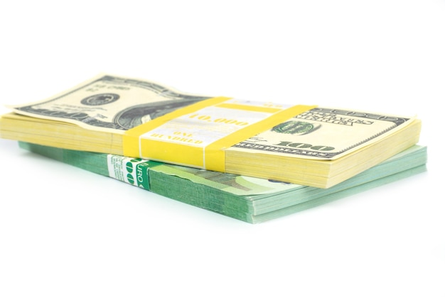 Stack of money cash of us dollars and euros isolated