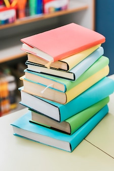 Stack of multicolored books on table