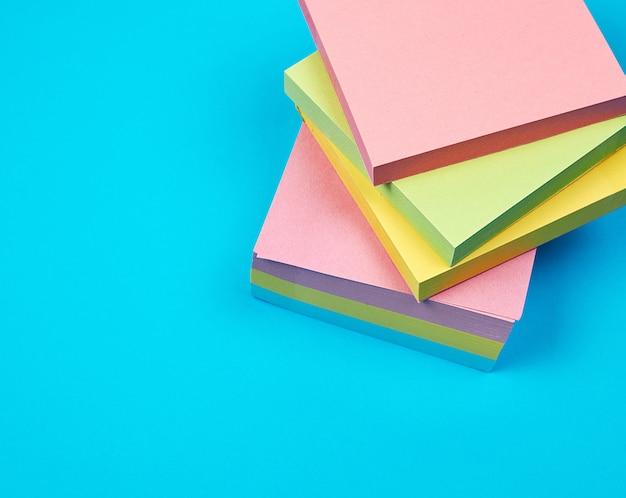 Stack of multicolored empty paper square stickers