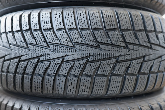 Stack of new black car tires with tread choice of rubber for car concept