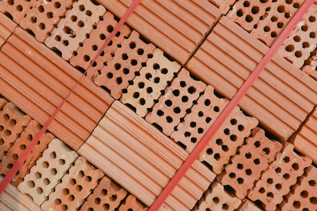 Stack of new red brick pack background