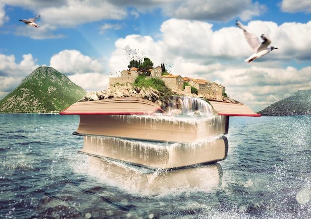 素敵な島が上にある本の山。本の物語の想像力