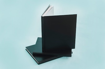 Stack of notebooks with black cover